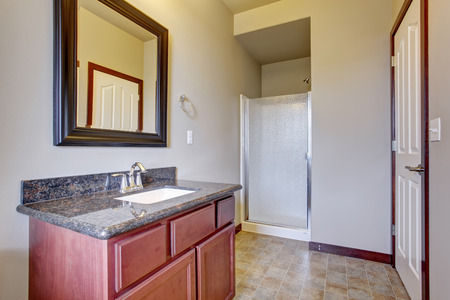 Classic bathroom with tile floor, great lighting, and small shower.