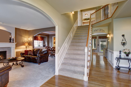 elegant entry way with stairs, hardwood floor, and arched door way.