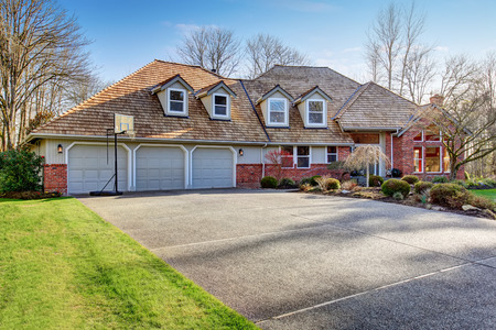 American traditional home with large driveway and garage.