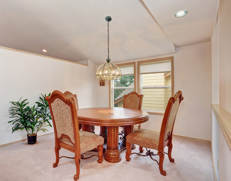 table and chairs: Simplistice dinning room with carpet, and nice table chairs set.