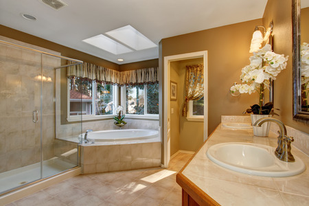 bathroom mirror: Large elegant master bathroom with shower, and big bath tub.