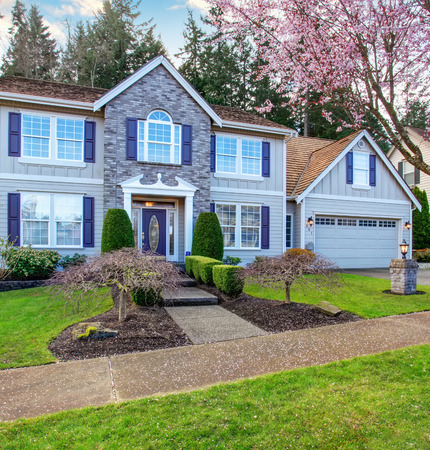 State of the art home with beautiful style, also green grass, and a beautiful walkway.