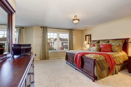 master bedroom: Beautiful master bedroom with carpet, including large vanity with drawers. Stock Photo