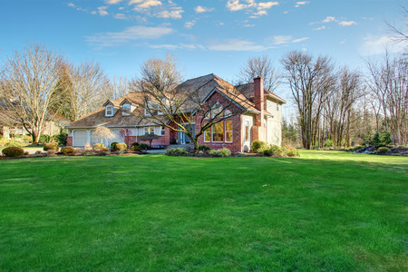 large: American traditional home with large driveway and garage.