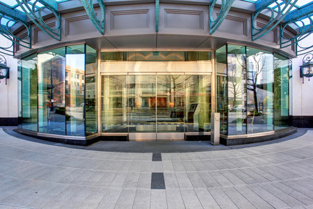 Front of luxurious apartment building, with glass windows and doors. 写真素材