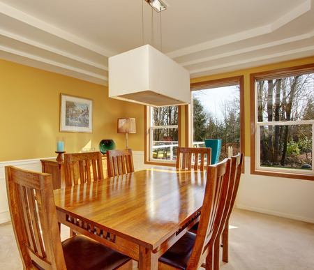 wood molding: Modernized dinning room with very nice table and chair set.