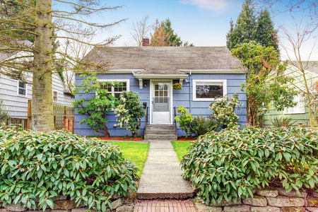 white door: Authentic house with an abundance of greenery and an adorable walkway to white door.