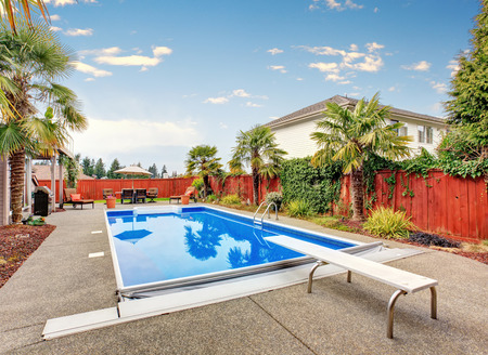 northwest: Luxurious northwest home with large pool and covered seating area. Stock Photo