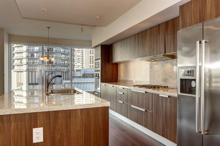 stainless steel kitchen: Perfect modern kitchen with hardwood floor and stainless steel fridge. Stock Photo