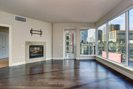 hardwood: Large empty living room with fireplace and hardwood floor.
