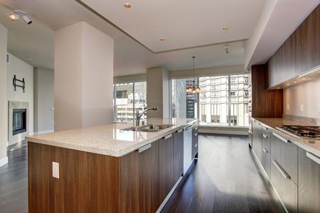 hardwood floor: Perfect modern kitchen with hardwood floor and stainless steel fridge. Stock Photo