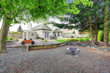 Large back yard with grass, and furnished patio, also a fire pit