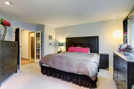 Lovely master bedroom with pink and black theme. Stock Photo
