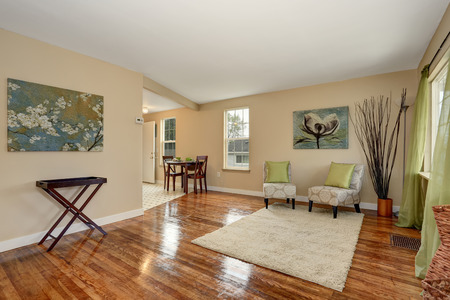 Lovely hardwood floor room with green and blue decor.