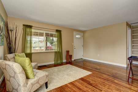 hardwood floor: Lovely hardwood floor room with green and blue decor.