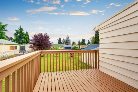 wood deck: Small back yard with well kept wod deck.
