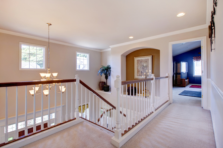 new entry: Brilliantly bright hallway with elegant white interior, and carpet. Stock Photo
