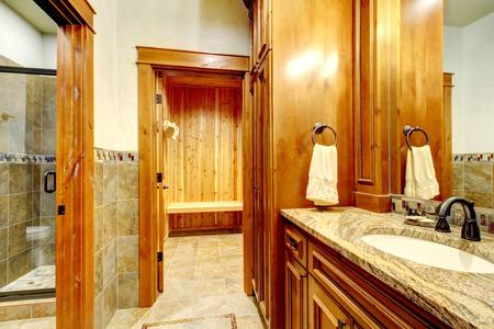 Luxury master bathroom with a large sauna. Stock Photo