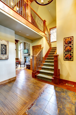 Elegant front enterance to home with nice staircase. Stock Photo