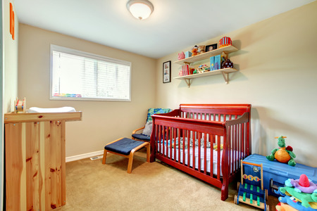 Simple baby bedroom with nice crib and carpet.