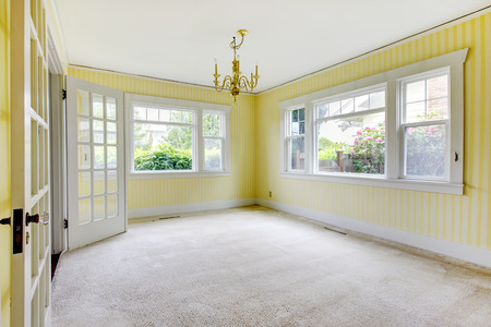 yellow walls: simple room with carpet, and yellow striped walls.