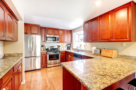 cabinets: Kitchen with nice counters and stained cabinets. Stock Photo