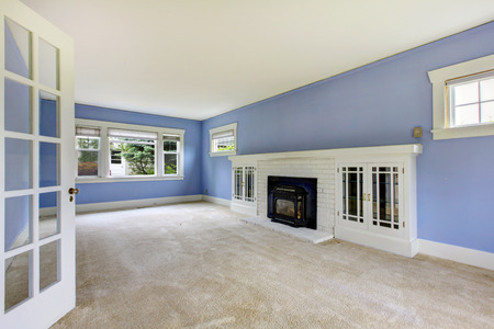 unfurnished: unfurnished room with carpet, and periwinkle walls.