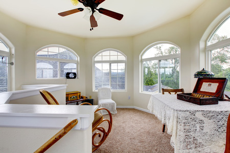 Nice room with cream walls, carpet, and chairs. Stock Photo