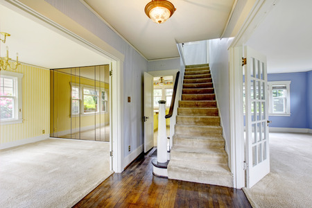 simple entry way to home with carpet stairs and soft colors.