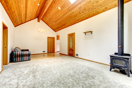 unfurnished: unfurnished living room with carpet, and hard wood.