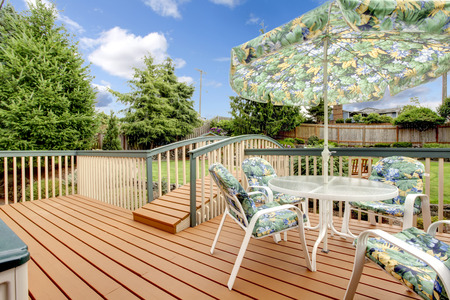 deck: Large deck with nature patterned table set.