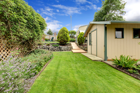 Back yard with green house shack, and garden. Stock Photo