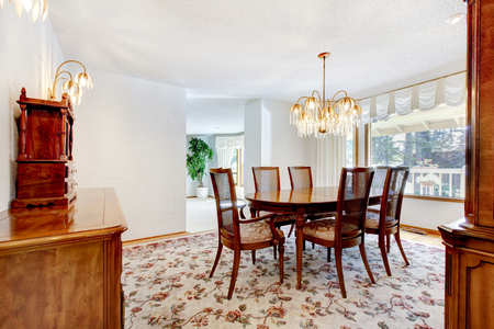 perfect dinning room with decorative rug and table set. Stock Photo