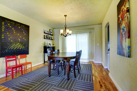 chandelier  kids: Nice yellow family room  with a chalkboard Stock Photo