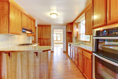 polished floor: Brown kitchen interior with polished hardwood floor Stock Photo