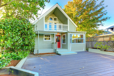 northwest: Beautiful green northwest home with wooden porch and trees around Stock Photo