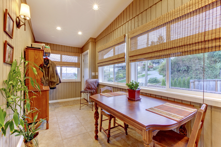 sunroom: Summer sun-room with play table and coat closet.