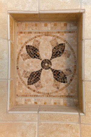 Natural stone beige tiles mosaic with shelve in bathroom.