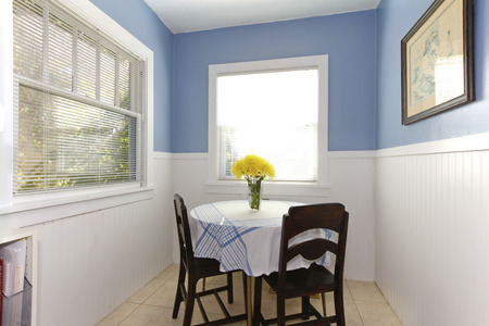 dining table and chairs: Bright small dining room with carpet windows, table and chairs.