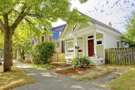 home exterior: Old small green home with porch. Stock Photo