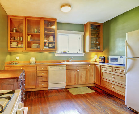 kitchen cabinets: Simplistic kitchen room interior with glass doors cabinets, green walls and hardwood floor
