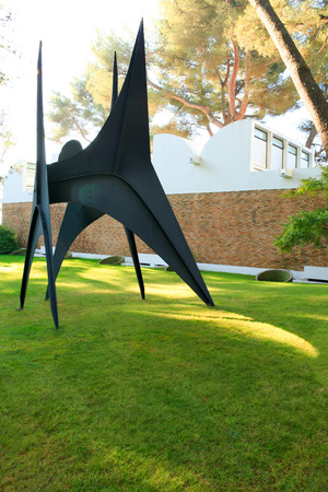 Nice, France - October 22, 2011. Foundation Maeght. Sculpturs in outdoor garden. Alexander Calder's stabile Les Renforts. Modern European art. Small private museum.