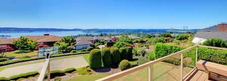 rental property: Screened wooden walkout deck overlooking beautiful landscape.