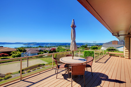 screened: Beautiful screened walkout deck with patio table and chairs overlooking nice landscape Stock Photo