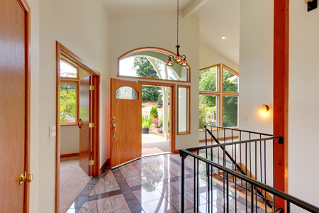 vaulted ceiling: Nice bright entry way to home with high vaulted ceiling, tile floor and staircase.