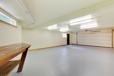remodeled: White bright new empty garage with lots of space. Stock Photo