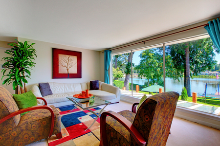 classic living room: Classic red and blue living room interior with comfortable furniture set, carpet floor and large window.