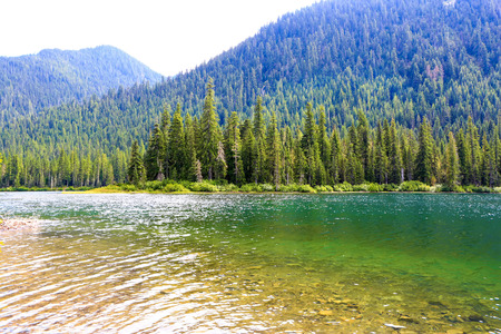 Scenic Mountain green Lake with transparent water. Nice landscape