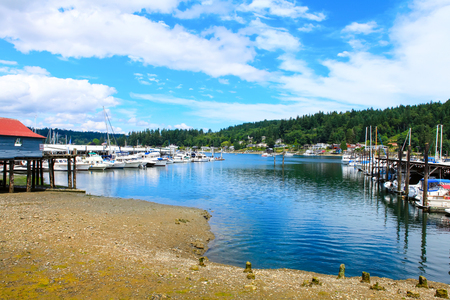 gig: Gig Harbor, WA - September 25, 2011: Small town downtown marina area. Blue sky Editorial