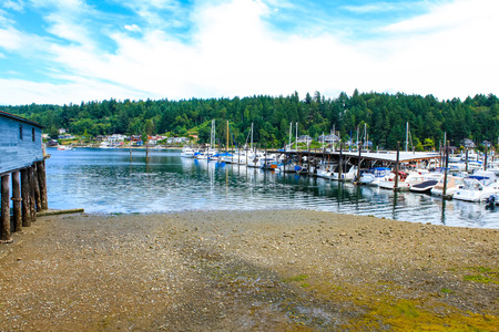 puget sound: Gig Harbor, WA - September 25, 2011: Small town downtown marina area. Blue sky Editorial